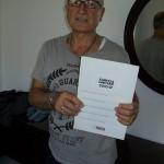 Franco Cecconi reparto pianoforti Farfisa con il manuale 5200 R